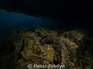 Motorcycles in the Thistlegorm wreck by Pieter Firlefyn